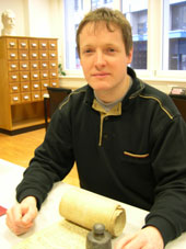 Walter Raaflaub at the Fribourg State Archives with the 1355 Vanel rent-roll